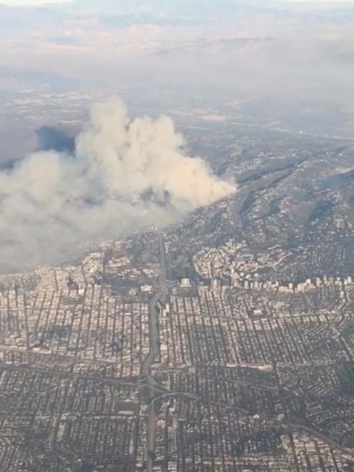 Smoke rises from a wildfire in 405 highway in Los Angeles. Photo: Reuters