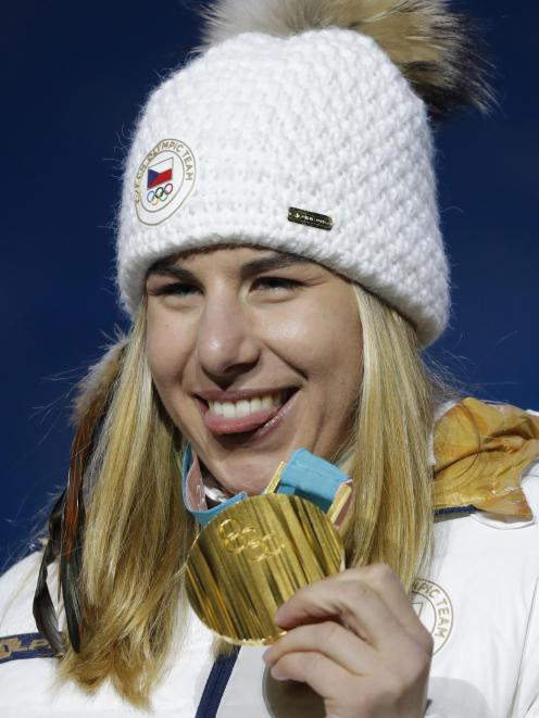 Ledecka with her gold medal. Photo: Reuters