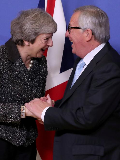 Theresa May also met with European Commission President Jean-Claude Juncker in Brussels. Photo: Reuters