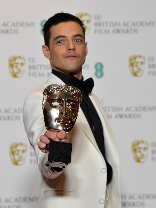 Rami Malek took the Leading Actor award for playing Queen's Freddie Mercury. Photo: Reuters