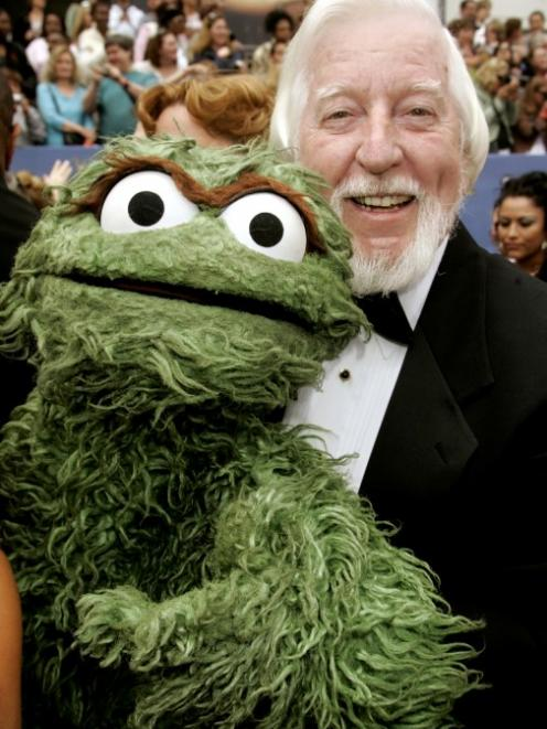 Caroll Spinney poses with Oscar the Grouch as they arrive at the 33rd annual Daytime Emmy Awards...