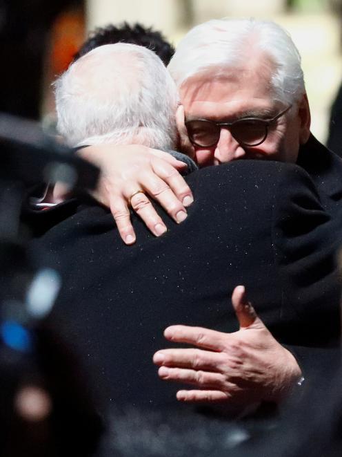 German President Frank-Walter Steinmeier and Israeli President Reuven Rivlin embrace as they...