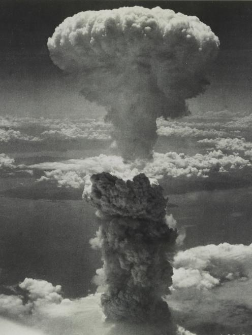 A giant mushroom cloud billows in the sky after the bomb was dropped on Hiroshima in 1945. Photo:...