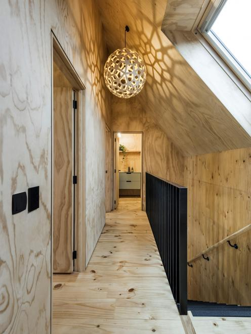 Skylights provide daylight to the hallway, which connects the two equal-size upstairs bedrooms.