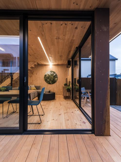 An easy connection between the interior and exterior spaces is provided by floor-to ceiling...