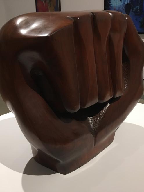 The raised fist of Elizabeth Catlett's 'Black Unity' sculpture symbolises resistance and...