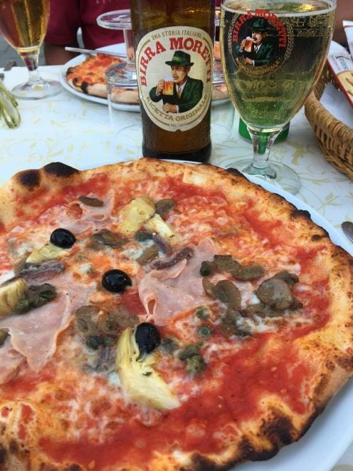 Pizza and a beer makes a perfect meal in Burano.