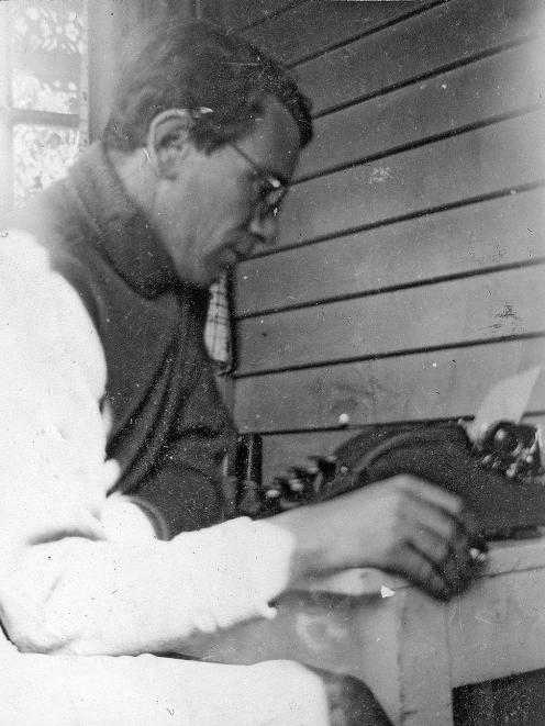 Curnow at his typewriter, intensely focused on his writing. He often worked late at The Press, and would get down to his poetry after he came home.  PHOTO: PRIVATELY HELD