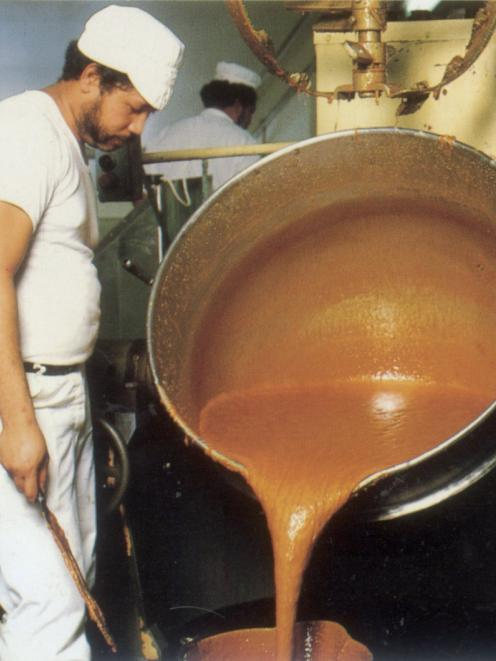 La Faatoese pouring hot caramel destined for Picnic and Moro bars, during the 1980s. Photo:...