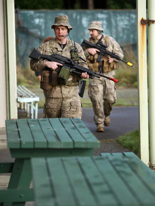 NZ Army Reserve Force soldiers from Invercargill and Cromwell clear the clubhouse at the vacant...