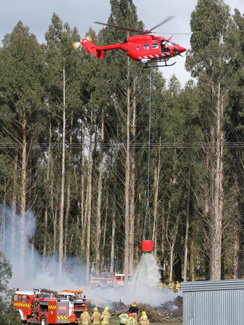 Two choppers were called to deal with the blaze. Photo: John Cosgrove