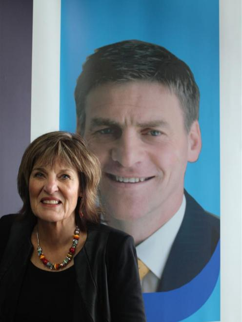 Former Gore electorate agent Glenys Dickson, in front of the Clutha/Southland electorate office featuring an image of its then MP, Bill English. Photo by Margaret Phillips.