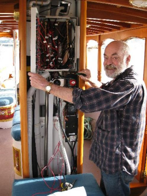 Former electronic engineer Terry Middleditch shows off some of the  electrics on the historic Otago Harbour ferry. Photo by Phillip de Wattignar