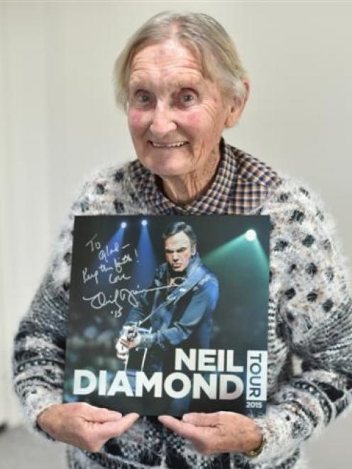 Glad Barnes shows the tour programme Neil Diamond personally signed, which was given to her at Forsyth Barr Stadium on Saturday. Photo by Greg Richardson.