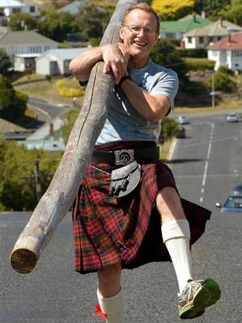Caledonian Society of Otago member Ian McDonald with the caber needing a lift to Queenstown for the New Zealand Rural Games. Photo by Stephen Jaquiery