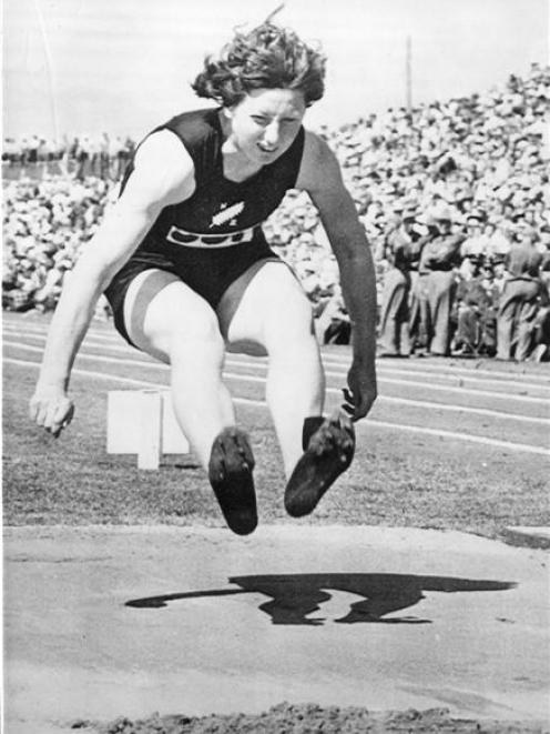 Yvette Williams wins the women's long jump at the Empire Games in Vancouver in 1954.