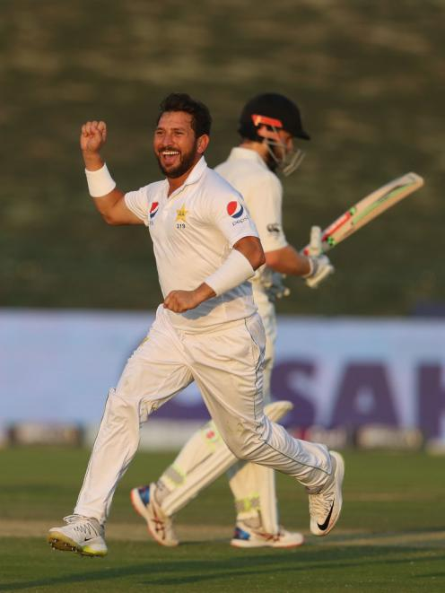 Yasir Shah celebrates the wicket of Tom Latham. Photo: Getty Images
