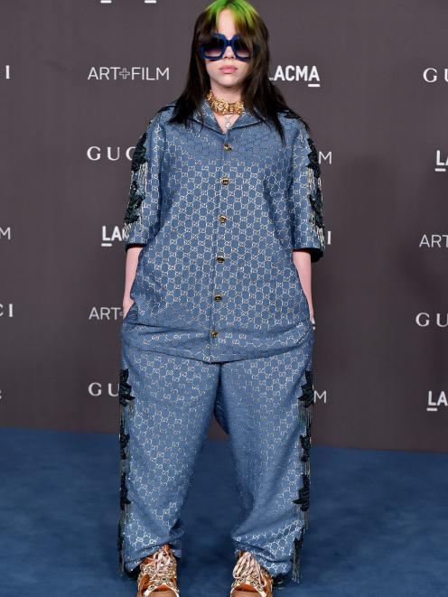 Pop star Billie Eilish tends to dress androgynously and shop across genders. Photo: Getty Images