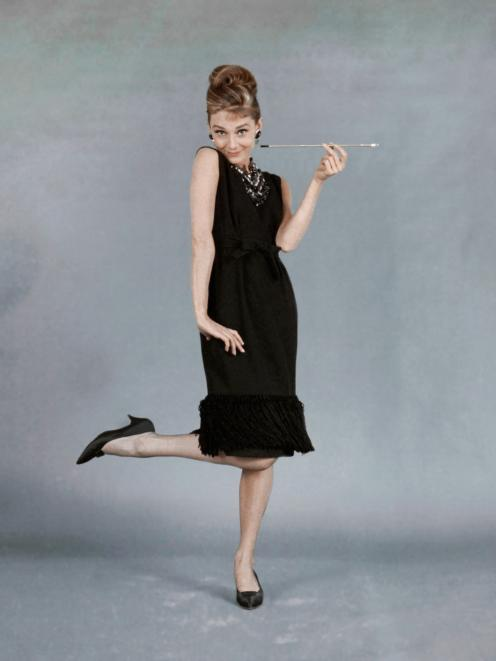 Audrey Hepburn wearing the famous black dress in Breakfast at Tiffany's. Photo: Getty Images