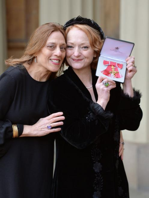Stella Duffy (right) with partner Shelley Silas after she received her Officer of the  Order of...