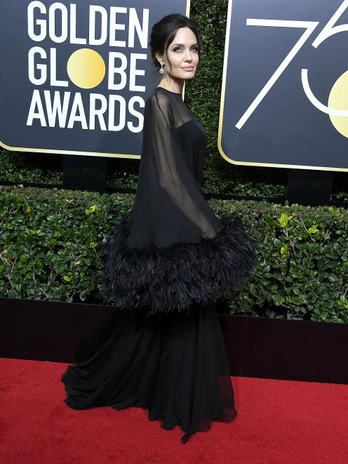 Angelina Jolie wore a stunning dress trimmed with feathers by Atelier Versace. Photo: Getty Images