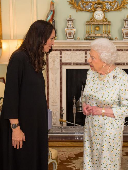 Prime Minister of New Zealand Jacinda Ardern is greeted by Queen Elizabeth II during a private...