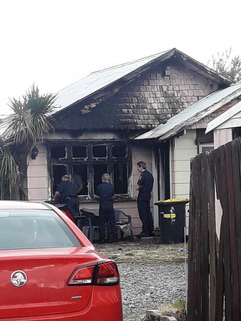 Firefighters were called to a house fire in North New Brighton on Friday morning. Photo: Louis Day