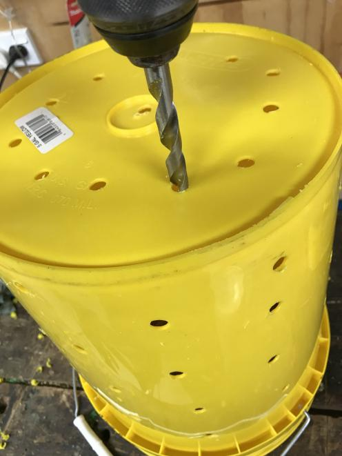 Drill holes all over the bucket. Photo: supplied
