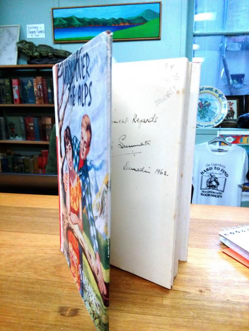 An autographed first edition copy of  Moon Over the Alps, by Essie Summers, published in 1962 and...