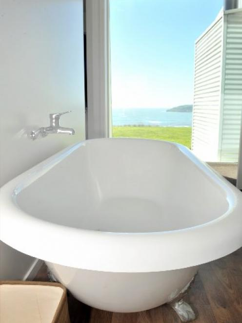 The bath in the en suite is perfectly positioned for the view.