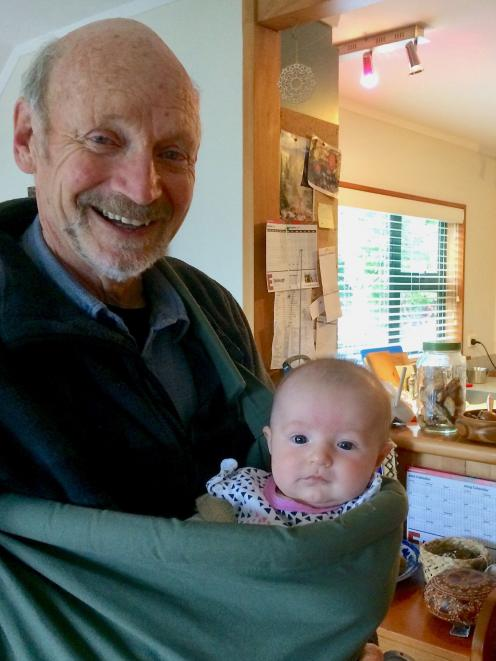 Author and conservation educator Neville Peat with his granddaughter Grace,  who was born this .