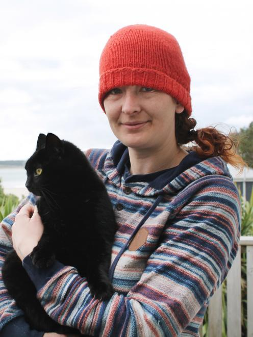 Cat-lover Nico Jarvis with her neighbour's 8-year-old cat, Nhabuz Fishaw. Photo: ODT files