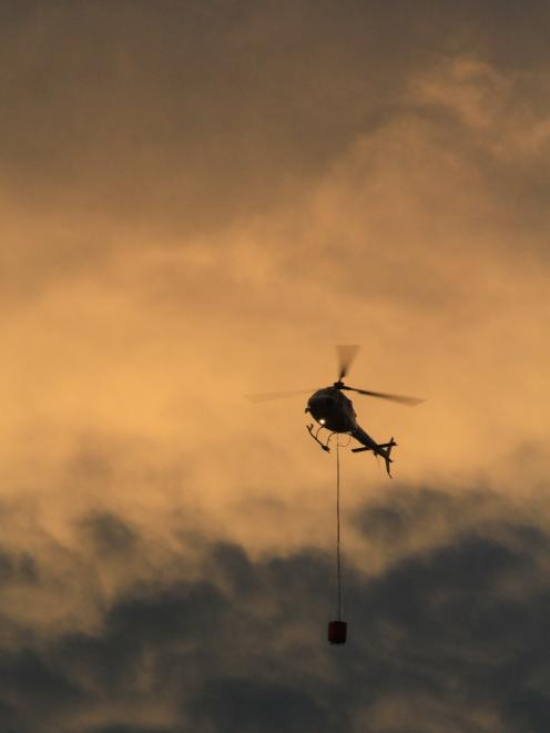 Helicopters with monsoon buckets were called in late afternoon. Photo: Hamish MacLean