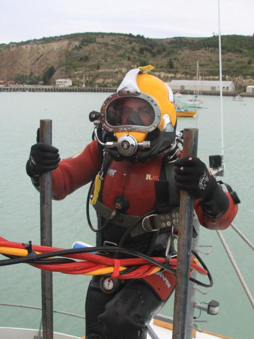 Bays Underwater Services diver Luke Wright heads below the deck to inspect the deterioration of...