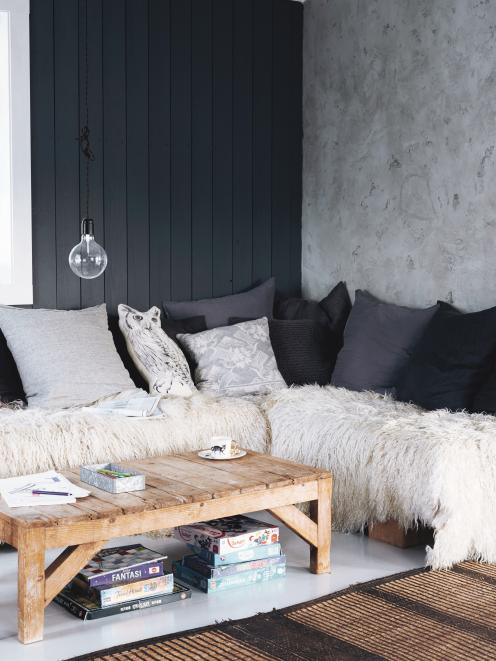 A spectrum of greys has been used in this modern monochrome look, but despite the cool shades, a...