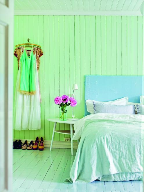 One wall in this room has been painted a soft aquamarine that would be perfect for a coastal home...