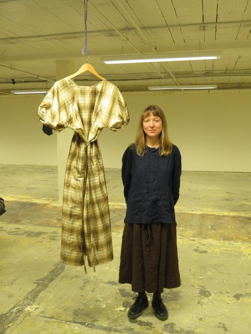 Paige Jensen with one of her designs in the Underground retail space. PHOTOS: MAUREEN HOWARD