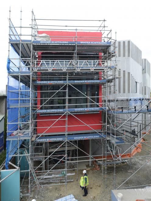 The new University of Otago music, theatre and performing arts building on Union St emerges.