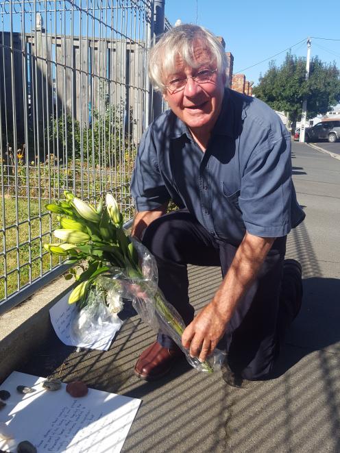 Peter Belton lays flowers outside the Dunedin mosque. Photo: David Loughrey