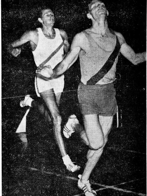 Peter Snell crosses the line first just in front of John Davies at the Caledonian Ground in...