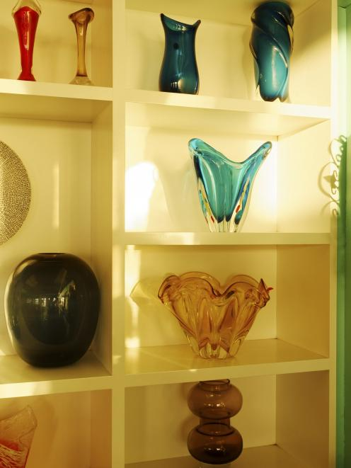 Shelves of glass vases from Italy - a riot of colour and shapes.