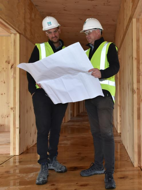 Naylor Love project manager Cameron Orr (left)  and operations manager Jason Tutty look at plans the west wing of the Otago Polytechnic's  $20 million student village project. PHOTO: GREGOR RICHARDSON