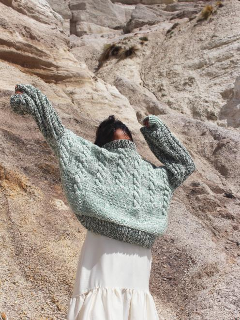 Outfit from the Tangible collection: hand-knitted jersey designed made from 100% New Zealand and...