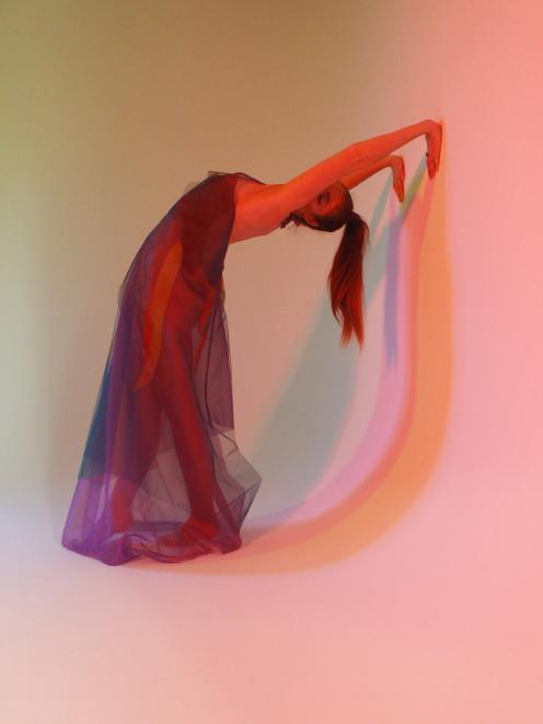 Alesha Pyers models her own creations created from tulle and organza  sculpted to mirror the body...