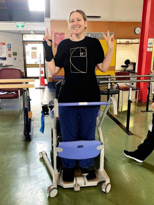 Rachel Jordan taking some of her first steps, three months after the helicopter crash. Photo:...