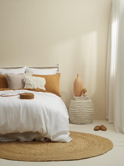 Channel golden sunsets and the warm sand of the beach with soulful neutrals and warming apricots...