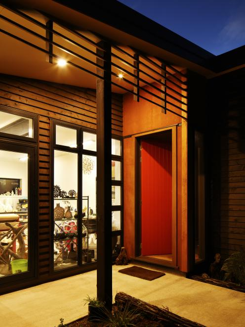 Front door in Resene Thunderbird with home in Resene Woodsman Natural.  Project by Aonui...