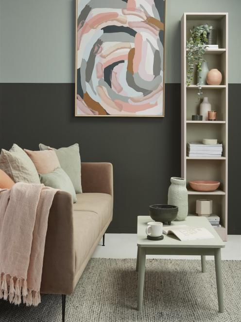 The top of the feature wall is in Resene Pewter, and the bottom in Resene Karaka to provide a...