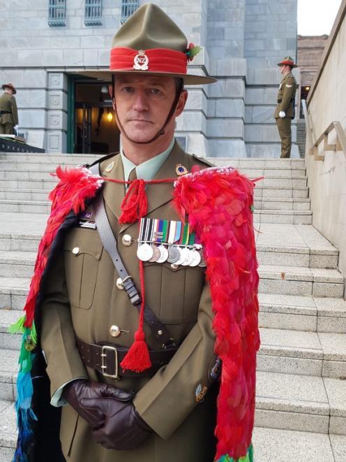 Warrant Officer Class One Robert Jobe wearing the cloak he wove. Photo: RNZ