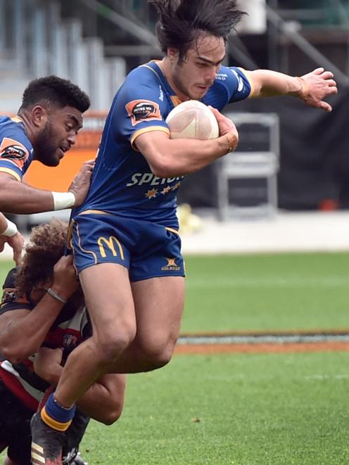 Otago centre Josh Timu tries to get away from Counties-Manukau midfield back Orbyn Leger....